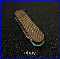 58mm Custom Swiss Army Knife with Brass Daily Custom Scales and Green Turboglow