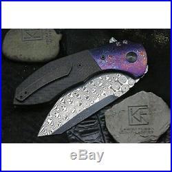 Custom Knife Factory CKF Spectra Damasteel-Timascus bolsters. Carbon fiber