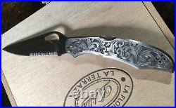 Hand engraved Spiderco CaraCara knife