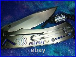 Titanium Blue Opal Benchmade Knife after Sebenza with Chris Reeves lanyard $895