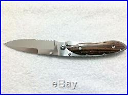 William Henry Evolution Folding Knife Rare Half Serrated